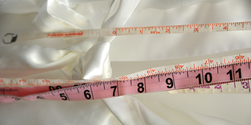 Photo of a fabric tape measurer that will help find your perfect fit at Isabella Boutique