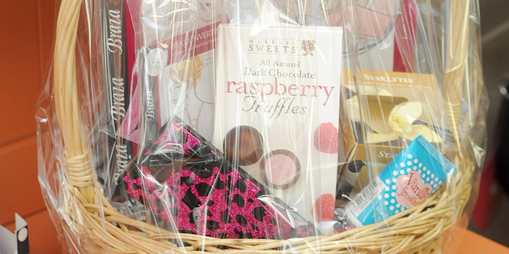 Photo of a gift basket loaded with goodies and chocolates - Sold at Isabella Boutique